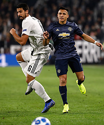 November 7, 2018 - Turin, Italy - Sami Khedira (L) of Juventus and Alexis Sanchez of Manchester United vie for the ball during the Group H match of the UEFA Champions League between Juventus FC and Manchester United FC on November 7, 2018 at Juventus Stadium in Turin, Italy. (Credit Image: © Mike Kireev/NurPhoto via ZUMA Press)