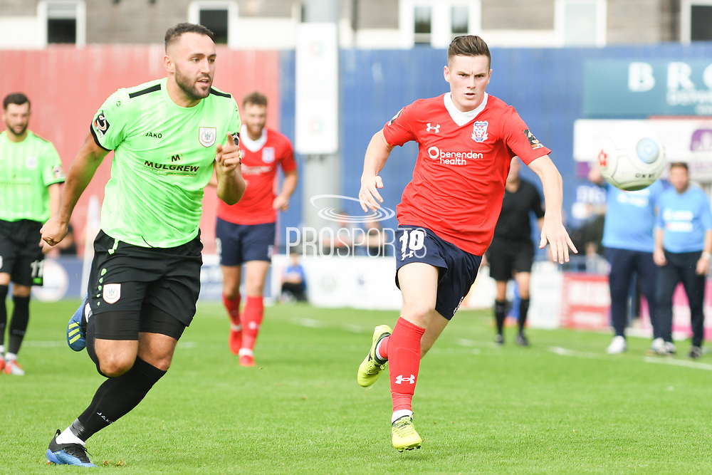 Macaulay Langstaff of York City (10) and Daniel Morton of Curzon Ashton (6) chase the loose ball during the Vanarama National League North match between York City and Curzon Ashton at Bootham Crescent, York, England on 18 August 2018.