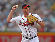 ATLANTA - JUNE 25:  Pitcher Derek Lowe #32 of the Atlanta Braves throws to first on a pickoff attempt during the game against the New York Yankees at Turner Field on June 25, 2009 in Atlanta, Georgia.  The Yankees beat the Braves 11-7.  (Photo by Mike Zarrilli/Getty Images)