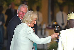The Prince of Wales and Duchess of Cornwall during a state dinner and reception at the Coco Ocean Hotel, on day two of their trip to west Africa.