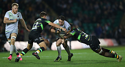 Northampton Saints Piers Francis (left) and Teimana Harrison tackle Saracens Brad Barritt during the Champions Cup match at Franklin's Gardens, Northampton.