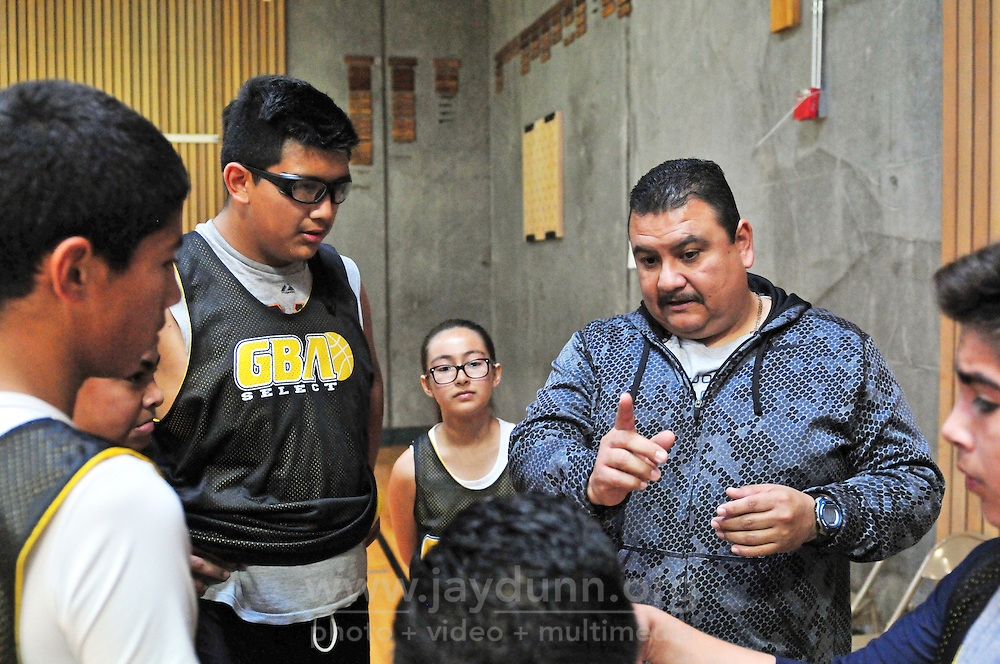 """A parent steps in to coach during a Saturday practice match at Alisal High School in Salinas. Athletes on the same team are in different stages of development. Gil Basketball Academy's mission is to """"support the youth of Salinas as they 'Shoot for and Reach' their positive goals, by participating in organized basketball camps, clinics, college tours, motivational speaker forums, field trips and trips beyond Salinas."""""""