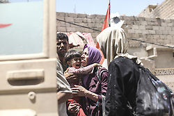 June 30, 2017 - Mosul, Iraq - A day after the Iraqi government declared the Islamic State was defeated in Mosul, heavy fighting persisted while newly liberated residents still fled the Old City neighborhood in droves. Many needed medical attention. (Credit Image: © Byron Smith via ZUMA Wire)