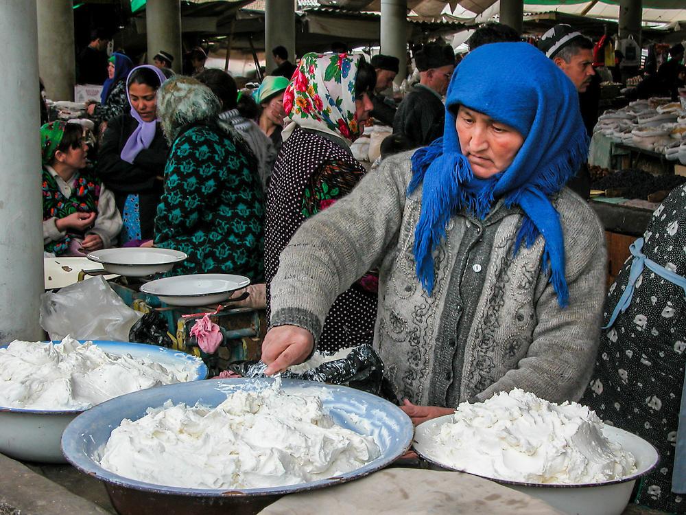 Portrait of a Tajik woman selling clotted cream or yoghurt (kaymak) in a market in western Tajikistan