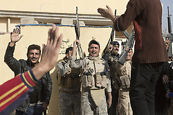 November 11, 2016 - Mosul, Nineveh, Iraq - Residents and Iraqi soldiers dance to music during a visit to Mosul's Al Antisar district by soldiers of the Iraqi Army's 9th Armoured Division. The Al Intisar district was taken four days ago by Iraqi Security Forces (ISF) and, despite its proximity to ongoing fighting between ISF and ISIS militants, many residents still live in the settlement without regular power and water and with dwindling food supplies.(Credit Image: © Matt Cetti-Roberts via ZUMA Wire)