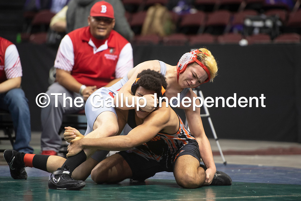 Bernalillo Spartan Joaquin Mares and Gallup Bengal Keshawn Smith wrestle in the first round of the New Mexico Activities Association State Wrestling Championships Friday morning at the Santa Ana Star Center in Rio Rancho.
