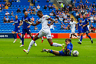 Cardiff City midfielder Tom Sang  (28) tackles Bournemouth forward Jaidon Anthony  (32) during the EFL Sky Bet Championship match between Cardiff City and Bournemouth at the Cardiff City Stadium, Cardiff, Wales on 18 September 2021.