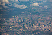 An aerial  view of the city of Shanghai from an airplane shortly after it took off from Shanghai Hongqiao Airport  in Shanghai, China, on Monday, August 8, 2016.