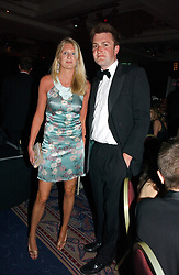 LADY MARIA BALFOUR and CHARLIE WIGAN at the Boodles Boxing Ball in aid of the sports charity Sparks  organised by Jez lawson, James Amos and Charlie Gilkes held at The Royal Lancaster Hotel, Lancaster Terrae London W2 on 3rd June 2006.<br /> <br /> NON EXCLUSIVE - WORLD RIGHTS