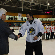 Mitchell Frear, New Zealand, receives the 'Best Player of the Team' award for the tournament from Kai Hietariinta, IIHF Tournament Chairman at the conclusion of the 2012 IIHF Ice Hockey World Championships Division 3 held at Dunedin Ice Stadium. Dunedin, Otago, New Zealand. 22nd January 2012. Photo Tim Clayton