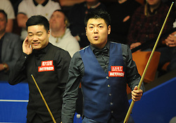 Liang Wenbo (right) during his match against Ding Junhui on day eight of the Betfred Snooker World Championships at the Crucible Theatre, Sheffield.