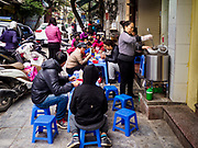 "22 DECEMBER 2017 - HANOI, VIETNAM: A woman makes ""pho,"" Vietnamese beef noodle soup, at her street stand in the old quarter of Hanoi. The old quarter is the heart of Hanoi, with narrow streets and lots of small shops but it's being ""gentrified"" because of tourism and some of the shops are being turned into hotels and cafes for tourists and wealthy Vietnamese.    PHOTO BY JACK KURTZ"