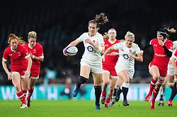 Emily Scarratt of England takes on the Argentina defence - Mandatory byline: Patrick Khachfe/JMP - 07966 386802 - 26/11/2016 - RUGBY UNION - Twickenham Stadium - London, England - England Women v Canada Women - Old Mutual Wealth Series.