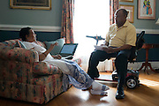 Johnny Lewis takes notes as he speaks with his wife, Shirley, at their home in Fort Worth, Texas on April 21, 2014. Johnny is the caretaker for Shirley who has been diagnosed with ALS. (Cooper Neill / for AARP)