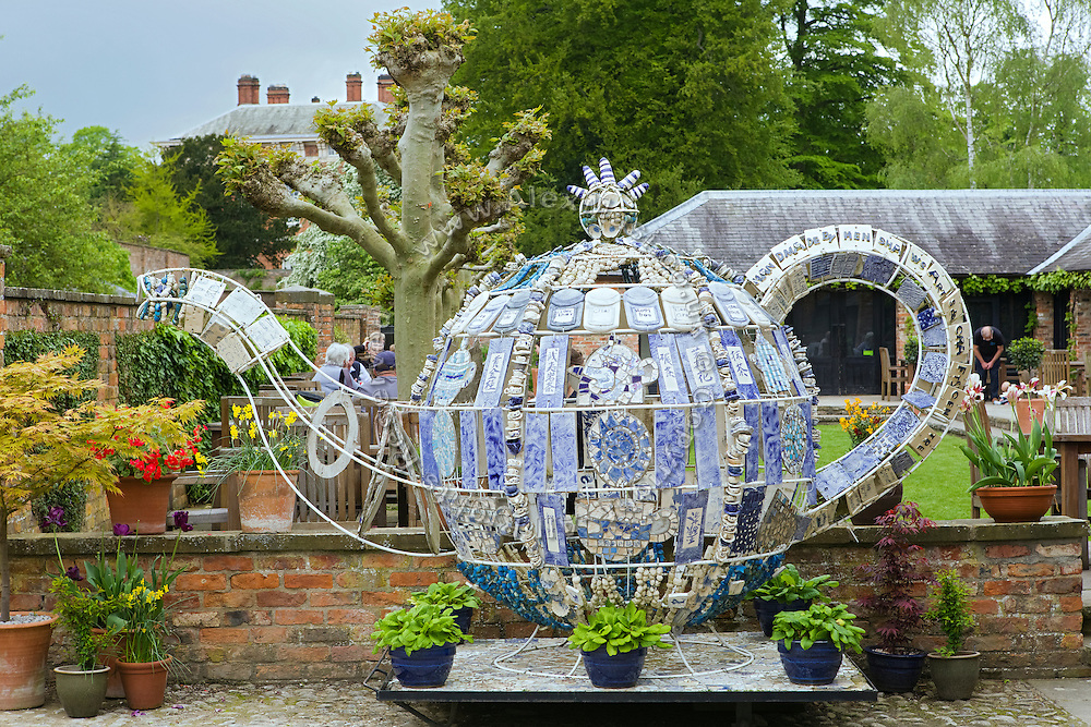 A large teapot art installation is standing inside Beningbrough Hall, Yorkshire, England, United Kingdom.