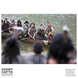 Maori warriors arrive in waka (canoes) at the premiere of the film River Queen in Wanganui, New Zealand.