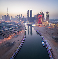 Aerial view of canal and illuminated skyscrapers in downtown Dubai at night, U.A.E.