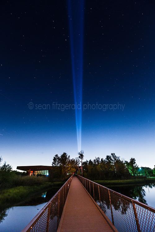 Spotlight above Trinity River Audubon Center building, Great Trinity Forest, Dallas, Texas, USA