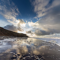 Morning light and reflections on the beach at Compton Bay, Isle of Wight.