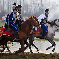 People dressed in period military dress attend the re-enactment of the historic battle of Hungarian army against Austrian soldiers of the Habsburg dynasty in Tapiobicske, 80 km (50 miles) southeast of Budapest, Hungary on April 04, 2013. ATTILA VOLGYI