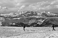 rocky mountain skyline with hikers