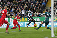 Newcastle United's Striker Papiss Demba Cisse narrowly misses to score, Liverpool's Goalkeeper Simon Mignolet watches the ball go wide during the Barclays Premier League match between Newcastle United and Liverpool at St. James's Park, Newcastle, England on 6 December 2015. Photo by George Ledger.