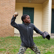 COLUMBIA, SOUTH CAROLINA - JANUARY 27: Stacey Isaac, resident of North Point Estate housing complex, throws a ball back to his father and baseball coach, Dana Isaac, in between buildings at their housing complex in North Columbia, SC on January 27, 2020. Stacey plays baseball on a team that his father coaches at their housing complex.    (Photo by Logan CyrusforThe Washington Post)