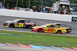 July 22, 2018 - Loudon, NH, U.S. - LOUDON, NH - JULY 22: (22) Joey Logano, (14) Clint Bowyer, and (24) William Byron in turn 4 during the Monster Energy Cup Series Foxwoods Resort Casino 301 race on July, 21, 2018, at New Hampshire Motor Speedway in Loudon, NH. (Photo by Malcolm Hope/Icon Sportswire) (Credit Image: © Malcolm Hope/Icon SMI via ZUMA Press)