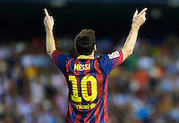 VALENCIA, SPAIN - SEPTEMBER 01:   Lionel Messi of Barcelona celebrates after scoring during the La Liga match between Valencia CF and FC Barcelona at Estadio Mestalla on September 1, 2013 in Valencia, Spain.  (Photo by Manuel Queimadelos Alonso/Getty Images)
