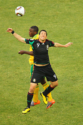 South Africa's  Aaron Mokoena vs Mexico's Guillermo Franco during the Group A first round 2010 FIFA World Cup South Africa match between South Africa and Mexico at Soccer City Stadium on June 11, 2010 in Johannesburg, South Africa.  (Photo by Vid Ponikvar / Sportida)