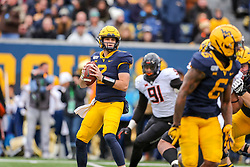 Nov 23, 2019; Morgantown, WV, USA; West Virginia Mountaineers quarterback Jarret Doege (2) drops back to pass during the second quarter against the Oklahoma State Cowboys at Mountaineer Field at Milan Puskar Stadium. Mandatory Credit: Ben Queen-USA TODAY Sports