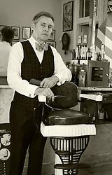 26 October 2014. New Orleans, Louisiana. <br /> New Orleans' bespoke gentlemen's barber  Aidan Gill<br /> Photo; Charlie Varley/varleypix.com