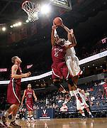Nov 6, 2010; Charlottesville, VA, USA; Roanoke College g Corey Poindexter (3) fights for a rebound with Virginia Cavaliers f Akil Mitchell (25) Saturday afternoon in exhibition action at John Paul Jones Arena. The Virginia men's basketball team recorded an 82-50 victory over Roanoke College.