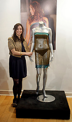 File photo dated 16/03/11 of designer Charlotte Todd standing by the transparent dress worn by the Duchess of Cambridge at a charity fashion show, which was watched by the Duke of Cambridge before she became his girlfriend, at La Galleria, London. University student Kate Middleton first caught the attention of 19-year-old Prince William when she strode down the catwalk in a sheer dress for a charity fashion show. Issue date: Wednesday April 28, 2021.