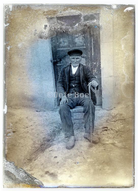 eroding glass plate with senior man sitting