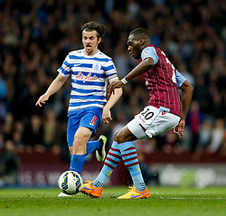 Christian Benteke of Aston Villa scores his second goal to make it 2-1 as Joey Barton of QPR challenfes - Photo mandatory by-line: Rogan Thomson/JMP - 07966 386802 - 07/04/2015 - SPORT - FOOTBALL - Birmingham, England - Villa Park - Aston Villa v Queens Park Rangers - Barclays Premier League.