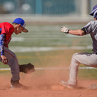 Miyamura Patriot Daniel McDonald (3) slides into second base ahead the tag from West Mesa Mustang Andrew Lucero (2) Saturday at the Gallup Sports Complex.