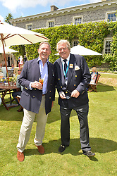 Left to right, PADDY McNALLY and the MARQUESS OF BLANDFORD at the Cartier hosted Style et Lux at The Goodwood Festival of Speed at Goodwood House, West Sussex on 29th June 2014.