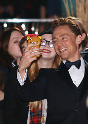 Actor Tom Hiddleston with his fans as he arrives for the World Premiere of his latest film Thor The Dark World, in London's Leicester Square, England, United Kingdom. Tuesday, 22nd October 2013. Picture by Max Nash / i-Images