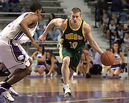 North Dakota State guard Ben Woodside (R) drives agaisnt pressure from Kansas State's Lance Harris (L) in the first half, during K-State's 82-56 win over North Dakota State at Bramlage Coliseum in Manhattan, Kansas, January 2, 2006.