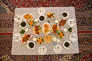 Lunch for guests at the home of  Atefeh Fotowat*, 17. Isfahan, Iran. *Atefeh Fotowat is one of the 101 people selected for inclusion in Peter Menzel & Faith D'Aluisio's upcoming book Nutrition 101 (2008) about what people around the world eat in one day's time.