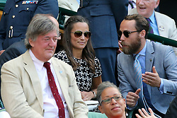 @ London News Pictures. 09/07/2015.<br /> From left to right Stephen Fry, Pippa Middleton and brother James watch Serena Williams beat Maria Sharpova in the semi finals of the Ladies Wimbledon Tennis Championships today.. Photo credit:LNP