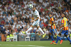 August 27, 2017 - Madrid, Spain - Karim Benzema heads the ball. LaLiga Santander matchday 2 between Real Madrid and Valencia. The final score was 2-2, Marco Asensio scored twice for Real Madrid. Carlos Soler and Kondogbia did it for Valencia. Santiago Bernabeu Stadium, august 27, 2017. Photo by  (Credit Image: © |Antonio Pozo |  Media Expre/VW Pics via ZUMA Wire)