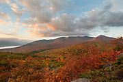 High Peaks Wilderness, Adirondacks, NY.  Wandering the tiny summit of Owls Head Mountain in Keene Valley, I watched the steady glow of sunrise descend from the peaks, illuminating the ridgelines and foothills as it lit them first, then washed downwards.  The clouds took on the light, though whether the light of morning or a reflection upwards of an intense autumn, was arguable.  All the colors of a rainbow,  I thought, fractured and rearranged, but the spectrum is still there.  I have images of perfect rainbows.  I think nature reserves their use to prove she's got one trick nobody can resist dropping everything to look at.  We're taught there's a pot of gold on the other side, like some kind of symbolic parallel to crossing the bridge of life, ascending and descending to a reward at the finish.   Halfway over though, I found I didn't want to feel like I already hit the high point, that the end is in sight.  So maybe this is more appropriate to the arc of my path, a rainbow shattered along the way and raining down in countless pieces. An imperfect attempt at success by an imperfect man.  I look out there and think, I've got a lot of climbing left to do.