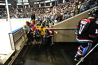 KELOWNA, CANADA, OCTOBER 11: Young fans high five the Kelowna Rockets as they exit the ice after the first period as the Medicine Hat Tigers visited the Kelowna Rockets on October 11, 2011 at Prospera Place in Kelowna, British Columbia, Canada (Photo by Marissa Baecker/shootthebreeze.ca) *** Local Caption ***