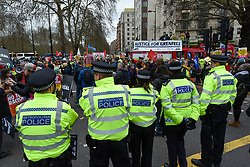 © Licensed to London News Pictures. 16/03/2019. LONDON, UK. A visible police presence surrounds the march. Thousands of people take part in a Stand Up To Racism and Stand Up To Islamophobia march through the capital.  Photo credit: Stephen Chung/LNP