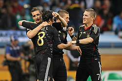 03.07.2010, CAPE TOWN, SOUTH AFRICA, Miroslav Klose, Mesut Oezil, Bastian Schweinsteiger of Germany celebrate Germany's fourth goal during the Quarter Final during the Quarter Final, Match 59 of the 2010 FIFA World Cup, Argentina vs Germany held at the Cape Town Stadium EXPA Pictures © 2010, PhotoCredit: EXPA/ nph/  Kokenge