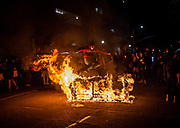 A demonstrator jumps over what appears to be a burning couch in downtown Sacramento on Saturday, May 30, 2020. Protesters reacted on Saturday to the death of Minneapolis man George Floyd.