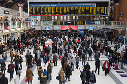 © Licensed to London News Pictures. 22/12/2017. London, UK. Liverpool Street Station in the City of London is busy shortly after lunchtime and much earlier than usual. Many office workers in the City appear to have finished work early today and have headed to pubs and bars or started their Christmas getaway early on Frantic Friday. Photo credit: Vickie Flores/LNP