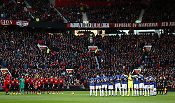 Both teams during a minutes silence as part of the football remembers campaign and for the victims of a helicopter crash at Leicester City